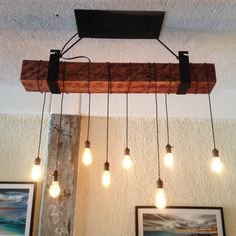 Cute Rustic Wooden Beam Industrial Chandelier Create your own rustic industrial chandelier for your modern farmhouse lighting with a reclaimed wood beam! A wooden beam suspended fro. Wood Floor Lamp, Wood Chandelier, Barn Wood, Industrial Chandelier, Reclaimed Wood Beams, Reclaimed Barn Wood Floors, Light, Reclaimed Barn Wood, Rustic Ceiling