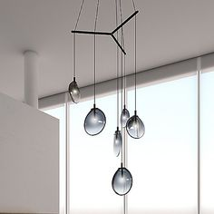 The Sonneman Cantina LED Tri-Spreader Multi-Light Pendant features flask-like glass ovals, each hosting their own energy efficient light source. Suspended from thin cables, the fixture rotates at random to create an asymmetric relationship with its surroundings. A single point of LED illumination within the void of the glass creates a special tension of scale and depth.