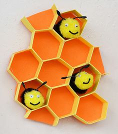 3-D honeycomb cell with pom pom bees