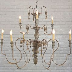 The Manoir, a rustic French inspired chandelier, uses wood and metal to create a lovely balance between masculine and feminine.