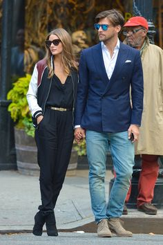 Olivia Palermo outfitted a chic jumpsuit with a sporty varsity jacket.