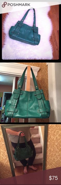 Sale! Tignanello Hobo Gorgeous green leather Tignanello hobo bag with silver hardware and chain link print silky lining; two exterior side pockets with several interior zippered and unzipped pockets. Long straps for shoulder use but you can also hold the bag on your arm. Perfect, unique coloring and exquisite interior lining. A beautiful pebbled leather bag; perfect condition with the exception of a tiny pen mark seen in the 5th photo. It could certainly be removed easily with leather…
