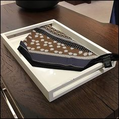 Table-Top Scarf Tray Visual Merchandising focuses attention on a folded designer offering. Visual merchandising causing one any who passed to look. Visual Merchandising, Knots, Tray, Nordstrom, Table, Design, Home Decor, Decoration Home, Room Decor