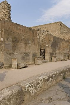 Pompei, main road and pedestrian way high from the  chariot road.