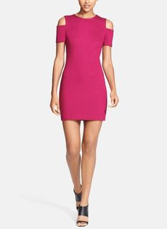 Hot! This bright pink cutout mini dress is sure to stop traffic.