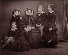 Queen Victoria with her eldest children. From left to right: HRH Prince Alfred, later HRH The Duke of Saxe-Coburg and Gotha, HRH Princess Alice, later HRH The Grand Duchess of Hesse and by Rhine, HRH Edward, Prince of Wales, later HM King Edward VII, HRH Victoria, Princess Royal, later Her Imperial Majesty The Empress Victoria of Gemany, Queen of Prussia and sitting at the Queen's feet HRH Princess Helena, later HRH Princess Christian of Schleswig-Holstein.