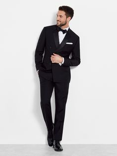Double Breasted Tuxedo by Ovadia and Sons. Unexpected and updated, the double-breasted tuxedo quietly injects black tie with personality. Featuring a six-button front and notch lapels, the jacket pairs with our black tuxedo pant for a flawless finish.