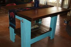 Kitchen island built from recycled pallet wood & rough cut walnut.