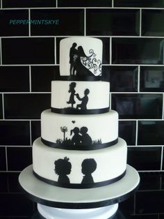 Couple's romantic story told in silhouette on wedding cake layers.