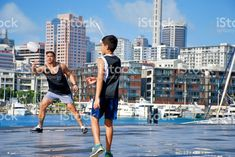 Pacific Islander Father and Son Playing Ball in Urban Cityscape Scene royalty-free stock photo Royalty Free Images, Royalty Free Stock Photos, Kiwiana, Scene Photo, Father And Son, Image Now, New York Skyline, Urban, City