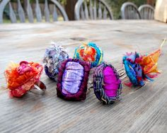 Locker hooked gift ideas using recycled silk and sari fabrics to create bangle bracelets and rings.