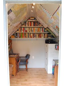 Garden shed interior - maps on the roof and books in the gable end.