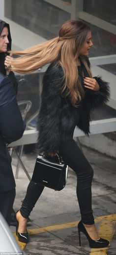 Strutting her stuff! Ariana Grande cut a stylish figure in an all black outfit of faux fur fluffy coat skinny jeans and heels - get the exact same coat from Topshop...x