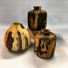 These incredible hickory pieces were created by IG @handcrafted_by_scott using Real Milk Paint Pure Tung Oil and Dark Tung Oil. These pieces were embellished with stippling using a pyrography pen and outlined. The vessel on the left was finished with our Pure Tung Oil while the other two were finished with our Dark Tung Oil. The Pure Tung Oil and Dark Tung Oil finish created a wonderful patina effect. Pure Tung Oil, Tung Oil Finish, Real Milk Paint, Stippling, Pyrography, Natural Wood, Woodworking, The Incredibles, Pure Products
