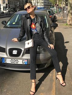 Black graphic t-shirt+black leather jacket+black high-waist jeans+black ankle-strap heeled sandals+white crossbody-bag+black sunglasses. Spring Casual Date / Going Out Outfit 2019 Two Strap Sandals, Ankle Strap, White Crossbody Bag, Leather Jacket Outfits, Black Sandals, Heeled Sandals, Black Leather, Instagram, Black Sunglasses