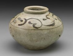 Vietnamese, Tran dynasty, 14th century, Vietnam. Stoneware with green glaze, underglaze iron decoration. 3 3/8 x 4 3/4 in.