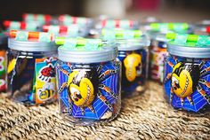 Bug Themed Birthday Party... Specimen Jar Favours with bug stickers and chocolate inside.   #birthdaypartythemes #birthdaypartyideas #bugparty