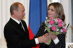 VLADIMIR Putin might have just got married as his rumoured glamorous partner was snapped showing off a huge wedding ring.