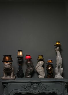 Made from glazed earthenware and coupled with Parisian silk lamp shades, these animal-inspired table lamps by Atelier Abigail Ahern are playful, witty, and classy kitsch! I clearly need the bulldog lamp .