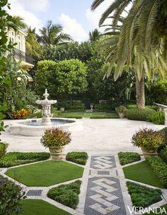 The garden is imbued with an old-world spirit. - Veranda.com