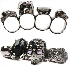 Alexander McQueen knuckle rings.