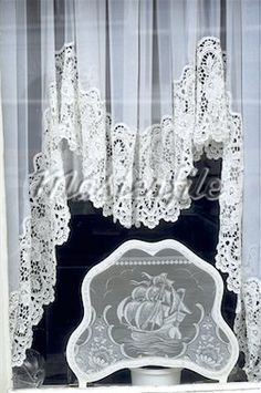 Typical Window, has Dutch Lace. Netherlands.  I have these in my Dutch kitchen's bay window.