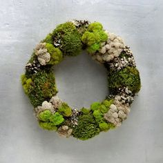 A vibrant blend of preserved clump moss, reindeer moss, sheet moss and lichen forms this hand-crafted wreath with deep forest appeal.- Preserved clump
