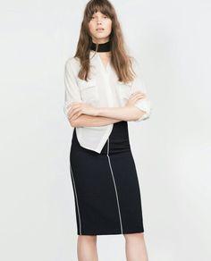 Black tube skirt with white trim. #Zara