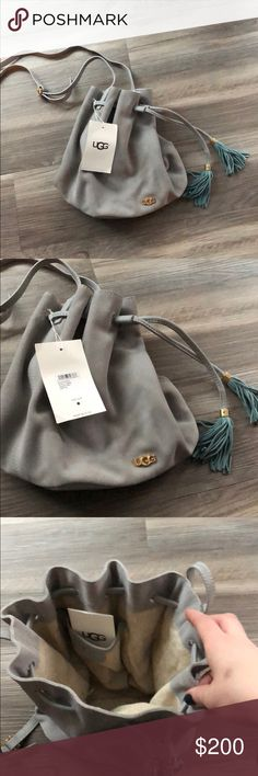 NWT UGG Rae Bucket bag Brand new with tags and dust bag!  Beautiful grey suede with gold hardware and blue suede tassels. Never used/worn. Has been in the dust bag since I bought it.  Open to reasonable offers. UGG Bags Crossbody Bags