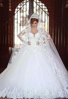 """Divorce isn't such a tragedy. A tragedy is staying in an unhappy marriage, teaching everyone around you the wrong things about love. Nobody ever died of divorce."" ― Jennifer Weiner, Fly Away Home - Sweetgirl White Lace Wedding Dresses with Long Sleeve Royal Train"