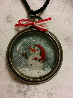 My cross stitched Snowman Christmas altered pocket watch inspired by ones made by The Twisted Stitcher  shown on her blog www.thetwistedstitcher.blogspot.com
