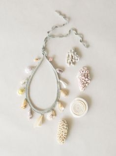 Plaited cotton necklace with shells and coral chopstick rests