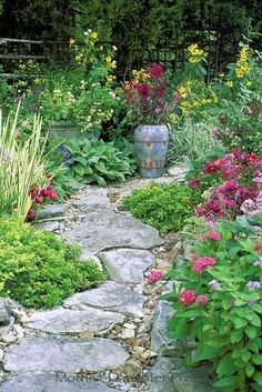 Flagstone path meandering through casual borders.