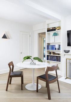 The other end of the living room serves as a dining area, with a table and chairs from DWR.