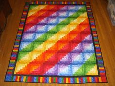 Rainbow log cabin quilt quilted and finished~Gorgeous!  I would love to make one of these.
