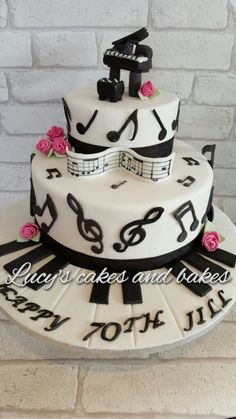 Music Cake 2 tier vanilla cake with white chocolate ganache and covered in fondant. the piano is RKT.