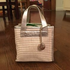 LAST DAY OF SALE!  Adorable vintage Furla mini bag Small ivory bag with silver trim, handles and bottom. Roomy zippered pocket inside. No signs of wear at all!  Great for spring and summer! Furla Bags Mini Bags