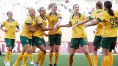 Kyah Simon of Australia is congratulated