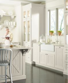 Love the cabinetry.  Perfect for a little brick cottage ;)