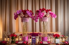 Pink, purple and gold reception decor with orchids and mirrored table