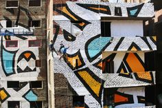 Epic Mural Spanning 50 Buildings Is Only Fully Visible From One Spot - http://www.gsmbible.com/epic-mural-spanning-50-buildings-is-only-fully-visible-from-one-spot/