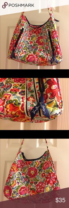 Vera Bradley Purse with front zippers In excellent condition. No stains or rips. It measures 12 in in length, 12 height, and 3 in height. Offers welcome! Vera Bradley Bags Shoulder Bags