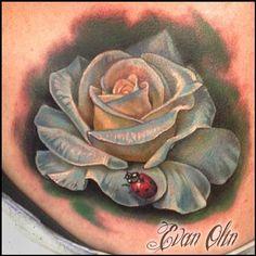 Evan Olin - Full color realistic rose and ladybug tattoo