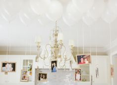 Who will not LOVE this baby shower decoration idea? You can definitely display old pictures and even baby pictures and create a mega throwback! Aside from using white balloons for baby shower decorations, you can go for a different color that matches your baby shower theme http://www.paperlanternstore.com/36-white-jumbo-round-latex-balloon-.html