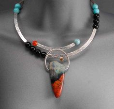 This reminds me of pieces pf Navaho jewelry my mom had in the 70's.