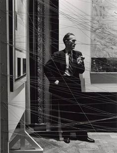 Arnold Newman, Marcel Duchamp behind his installation of 'Sixteen miles of string' New York, 1942