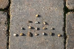 Play 'Nim' anywhere, any time, with just 16 small objects.  Player 1 chooses a row and takes as many or few stones as they wish, play continues turn taking.  The player to pick up the last stone loses.