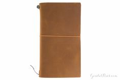 This is the starter's kit of the Traveler's Notebook (formerly Midori). It comes in a package which contains a cowhide cover, simple, blank notebook, a cotton case, and a spare rubber band (of different color).<b><br><br></b>