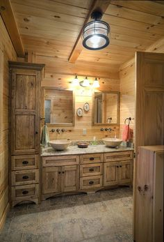 This log home bathroom by Hochstetler Log Homes boasts a double vanity and a spa. - This log home bathroom by Hochstetler Log Homes boasts a double vanity and a spacious storage cabin - Rustic Master Bathroom, Rustic Bathroom Designs, Rustic Bathroom Vanities, Rustic Bathrooms, Bathroom Ideas, Chic Bathrooms, Rustic Cabin Bathroom, Bathroom Cost, Bathroom Gadgets