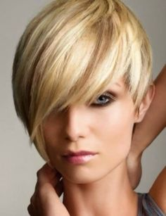Pixie cut with long bangs. More